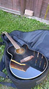 Ibanez Acoustic guitar + case + Spare strings