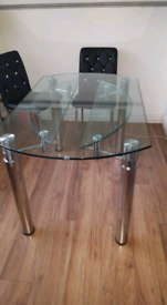 Glass extendable dinning table and chairs