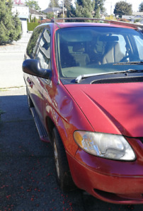 2003 Dodge Caravan.  Body rough, but  only 170,000 km and A/C!