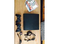 PS3 Slim, controllers, games and cables.