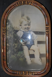 Old Photo in frame with rounded glass