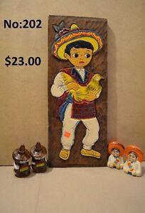 Sculpture sur planche de bois d'un mexicain