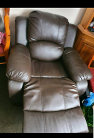 Almost New Brown Single leather recliner Sofa.
