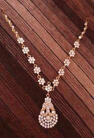 Beautiful gold plated maatha teeka,