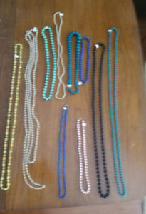 COLORFUL STANDS OF BEADS