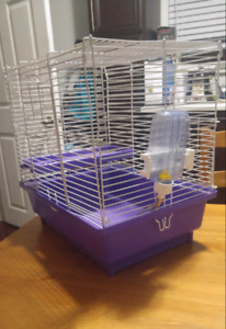 Cage, bedding and food for small pets.