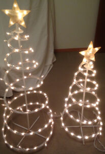 Two outdoor spiral light Xmas trees