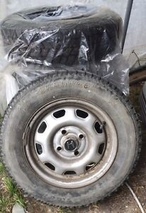 5 studded winter tires on rims 175/70R13