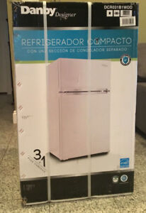 Selling NEW Danby two door mini fridge