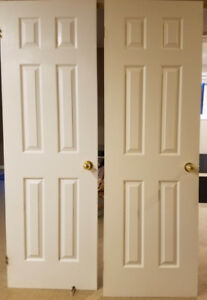 "White 6-panel closet doors with handles - 26"" x 80"""