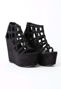 Size 8, new with box, without tags, faux suede wedge platform he