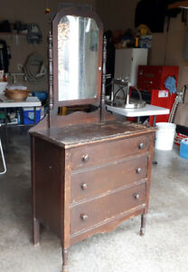 Antique dresser with tilting mirror.