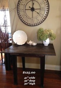 Occasional table made from an antique barn door