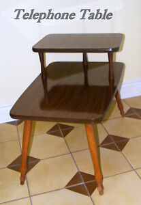 Gossip table1950s 2 tiers laminate tops rubber edges turned wood