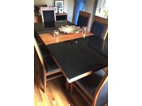 Walnut and black glass dining set