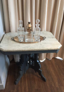 Antique painted table with a marble top