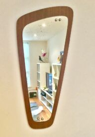 Mid-Century asymmetrical shaped mirror with a teak frame