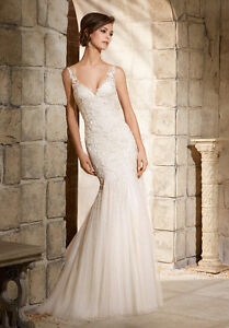 TAX INCLUDED ON ALL BRIDAL GOWNS OVER $800!!