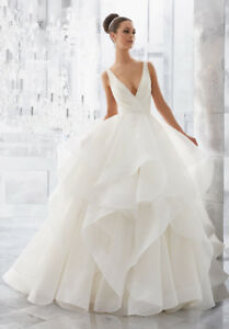 UP TO 70% OFF BRAND NEW WEDDING DRESSES + TAX FREE SALE!