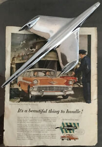 Classic 1950s-era automobile adverts & Chevy Bel Air hood orn't.