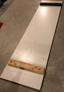 Home made slide board for youth hockey training.