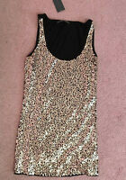 Brand new tags attached black/gold shiny top size small