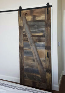 Interior sliding barn door hardware with soft close