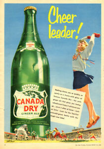 Large 1952 full-page color cheerleader ad for Canada Dry