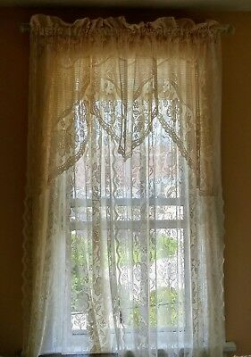 Shabby or vintage look lace curtain set that includes 2 panels and 1 valance.