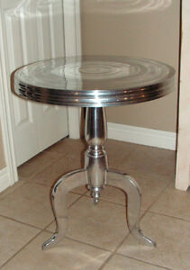 SILVER ALUMINUM ROUND TABLE