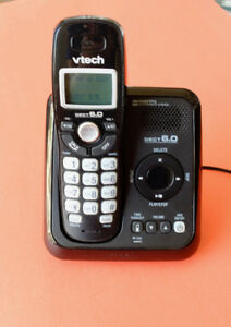 Cordless telephone with built in answering machine.