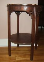 Antique carved mahogany side table.