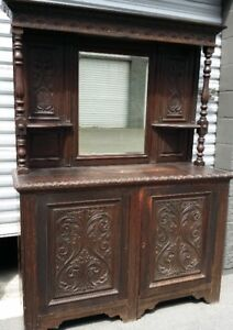 ANTIQUE HEAVILY CARVED MAGNIFICENT OAK MIRRORED SIDEBOARD