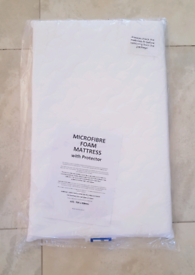 Baby Microfibre Foam Mattress with white sheet that comes separately