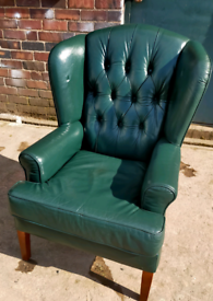 Lovely green leather wing back chair