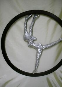 1960's Crome wheel with dancing girl