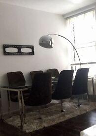 Practically NEW 6 modern velvet chairs.