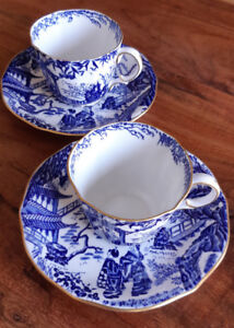 Two Blue Mikado Royal Crown Derby teacups and saucers