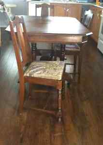 Antique Table and 6 chairs ( 1 captain chair).