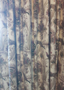 One pair of custom made heavy cotton printed drapes,lined, hooks