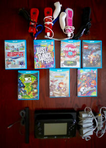 Wii U with 4 Controllers (Remote + Nunchuk) + 7 games