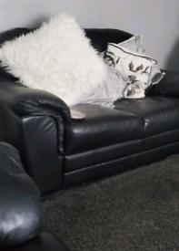 2 black leather 2 seater sofas
