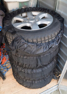 1 yr old Snow Tires on Nissan Altima OEM Rims