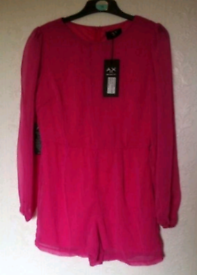 Pink playsuit new with tags