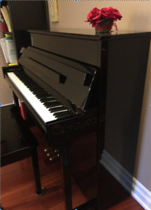 Upright German-Japanese piano in excellent condition