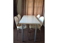 IKEA multi purpose dining room table or office desk with four chairs and cream seat cushions