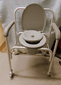 Brand new commode chair.