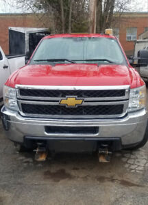 Red HD2500 Chevrolet pick up truck