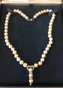 Genuine pearl and silver necklace and bracelet