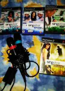 PS2 console,  karaoke mics with 4 singstar games